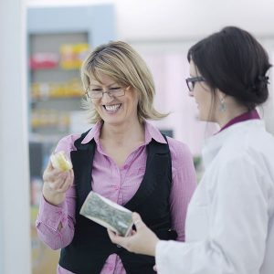 Woman Shopping With SalesPerson